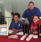 Bev, Louis and friend at his booth showcasing his hand-made native-inspired jewelry.